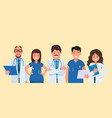 a team doctors on a yellow background vector image