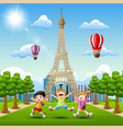 happy kids playing in front of eiffel tower backgr vector image vector image
