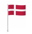 Flag of Denmark waving on a metallic pole vector image vector image