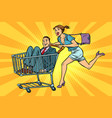 pop art woman with man in a shopping trolley vector image vector image