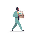 african american businessman carrying paper box vector image vector image