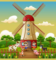 two boy are working again in front of windmill bui vector image vector image