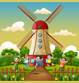 happy kids playing in front of windmill building b vector image vector image