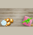 golden easter eggs cake and gift box on wooden vector image vector image