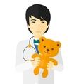 Pediatrician holding teddy bear vector image vector image