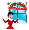 smiling woman standing near window christmas vector image vector image