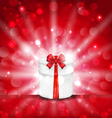 round gift box on light red background with glow vector image vector image