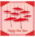 Chinese red umbrellas on abstract background vector image vector image