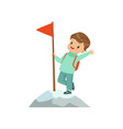 cute boy standing in mountain top wih flag kids vector image