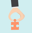 Pinch a piece of the jigsaw puzzle vector image