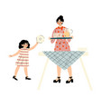 girl helping her mother set table family vector image vector image