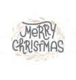 Merry Christmas lettering with a golden wreath vector image