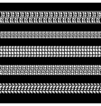 set white tire prints on black background vector image