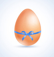 easter egg tied a blue ribbon with a bow vector image