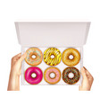 realistic donuts in box in hands vector image