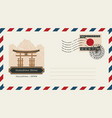 envelope with postage stamp and itsukushima shrine vector image vector image