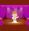 cute little boy wearing angel costume on stage vector image vector image