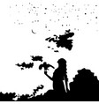 young girl silhouette with a bird on background vector image vector image