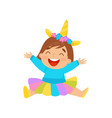 happy baby girl in unicorn costume sitting on the vector image vector image