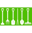 garden tools on green background vector image vector image