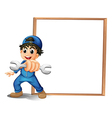 A boy with a wrench in front of the empty wooden vector image vector image