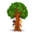 kids playing in an apple tree vector image