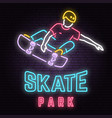 neon skate park sign on brick wall background vector image