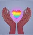 two open hands raised up holding rainbow heart vector image vector image