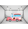 A pink ice cream car inside the garage vector image vector image