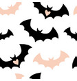 halloween pattern with black and pink bats vector image