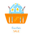 shopping basket with easter egg vector image