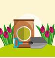 potting soil shovel and red tulips flowers garden vector image vector image