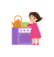 sweet little girl playing with toy kitchen oven vector image vector image