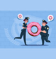 two police women holding donut wearing uniform vector image