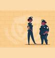 two african american police women wearing uniform vector image vector image