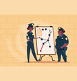 two african american police women planning action vector image vector image