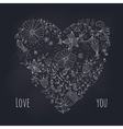 Floral heart on blackboard vector image