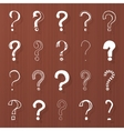 Question marks - hand drawn on wooden brown vector image