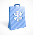 Festive paper bag with cut out snowflake for your vector image