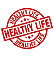 healthy life round red grunge stamp vector image vector image