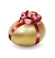 Easter gold egg with red bow and ribbon vector image