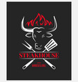 steakhouse logo with bull head on dark background vector image vector image