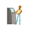 young black man using cash atm machine vector image