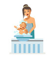 mother bathing newborn baby child maternity vector image