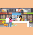 retail woman cashier at checkout supermarket vector image