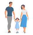 happy asian family holding hands and walking