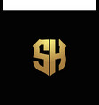sh logo monogram with gold colors and shield vector image vector image