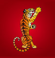 symbol of the year tiger standing on its hind legs vector image