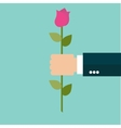 Rose Flower in a Business Man Hand vector image