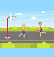 two boys playing basketball on playground vector image